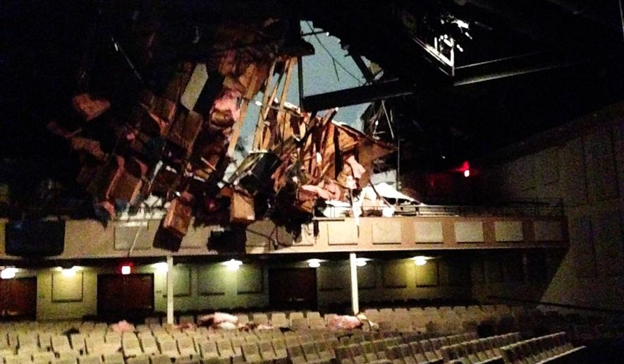 This Jan. 23, 2016 photo shows damage to the 1,100-seat auditorium at Calvary Fellowship Downingtown, a church outside Philadelphia, after its roof collapsed Saturday during a major snowstorm. Pastor Lee Wiggins celebrated Mass from his home Sunday via an online livestream. (Noelle Wiggins via AP)