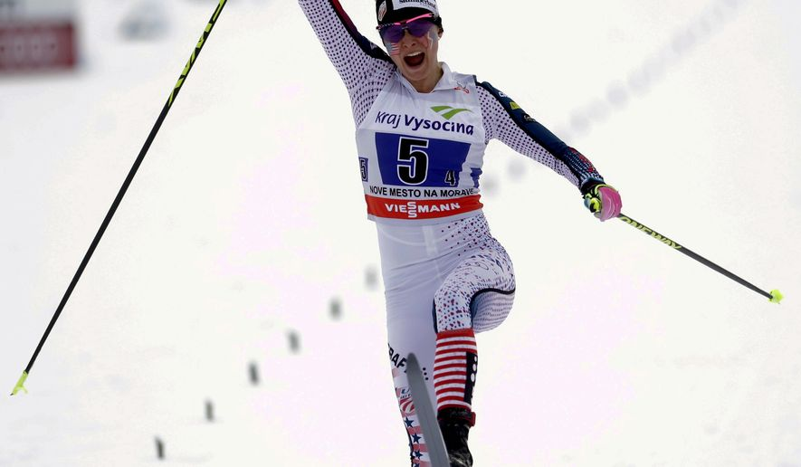Jessica Diggins of teh U.S.  celebrates after placing second in the women's 4x5 km relay race at the Cross Country Skiing World Cup in Nove Mesto na Morave, Czech Republic, Sunday, Jan. 24, 2016. (AP Photo/Petr David Josek)