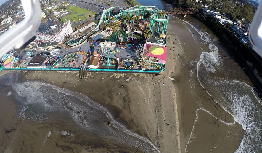 This Jan. 7, 2016 photo provided by The Nature Conservancy shows the San Lorenzo River overflowing around the Santa Cruz Beach Boardwalk, an oceanfront amusement park in Santa Cruz, Caif. The Nature Conservancy an environmental group in California is recruiting drone hobbyists to map flooding and coastal damage after El Nino storms with the idea that the images will help predict what the future coastline will look like as sea levels rise from global warming. (Matt Merrifield via AP)