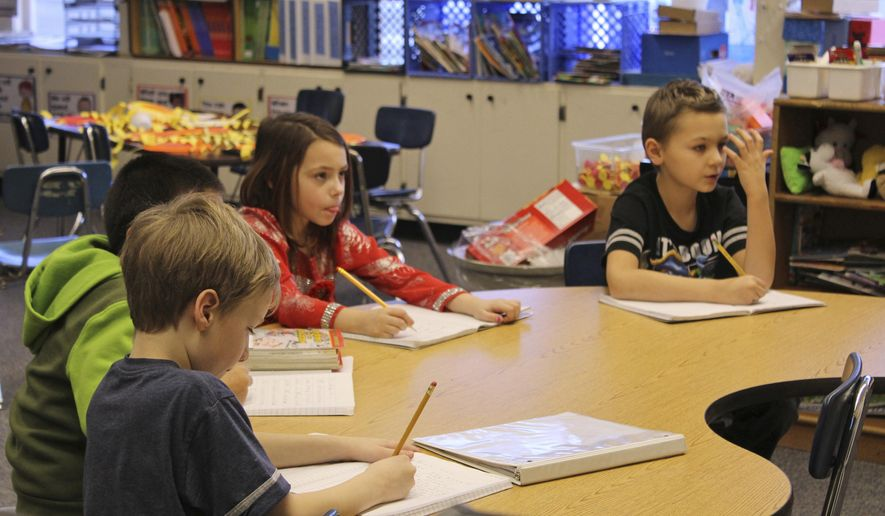 ** ADVANCE FOR WEEKEND JAN. 23-24, 2016 AND THEREAFTER ** In this Jan. 8, 2016 photo, students Aiden Crane, Lynnzi Stout, Alex Shae, and Quinton Blaine concentrate on a lesson in Jasmine Woodhead's first and second grade class at Chapman School in Anchor Point, Alaska. Chapman School has a philosophy of approaching students as individuals rather than how the student is identified by state testing demographics. Their small student population of 112 allows teachers to personalize learning. (Anna Frost/The Homer News via AP)