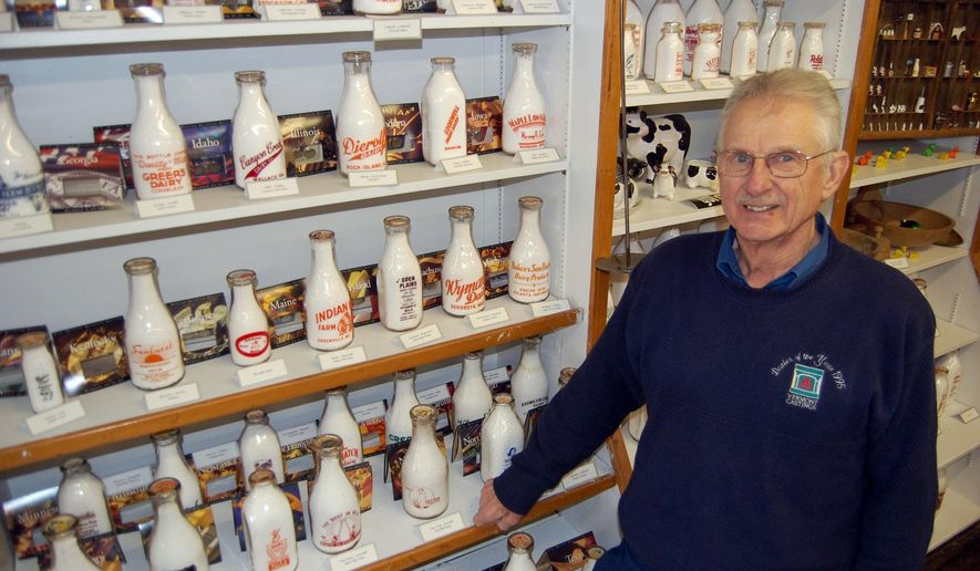 ADVANCE FOR THE WEEKEND OF JAN. 23-24 AND THEREAFTER - In a Jan. 12, 2016 photo, retired dairy farmer Larry D. Roth of Wayland, Iowa shows a portion of his milk bottle collection, which is on display at the Midwest Memories Museum and Shoppe and Wayland Museum. Roth opened the museum in 2009 to display dairy and other local memorabilia he had gathered over the years. ( Craig T. Neises/The Hawk Eye via AP)