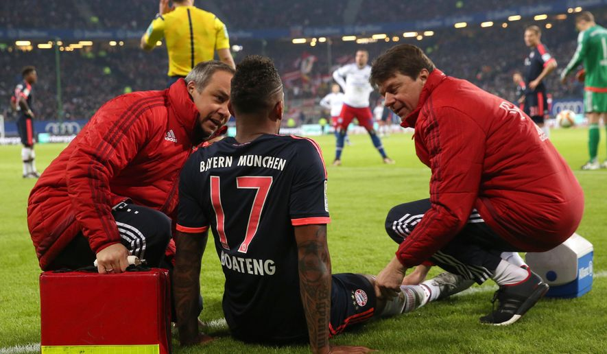 "FILE - In this Jan. 22, 2016 file picture Munich's Jerome Boateng is treated by team doctor Volker Braun, left, at the side of the pitch during the German Bundesliga football match between Hamburger  SV and Bayern Munich in Hamburg, Germany. Bayern Munich says  defender Jerome Boateng needs ""a long break"" after picking up a groin injury in Friday's 2-1 Bundesliga win at Hamburger SV.  ( Christian Charisius dpa via AP)"