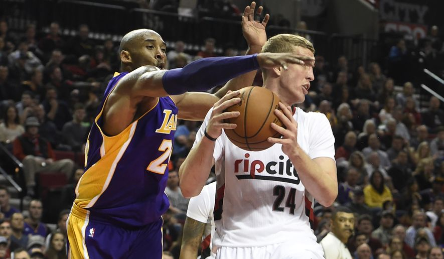 Los Angeles Lakers forward Kobe Bryant (24) reaches in on Portland Trail Blazers center Mason Plumlee (24) during the first half of an NBA basketball game in Portland, Ore., Saturday, Jan. 23, 2016. (AP Photo/Steve Dykes)