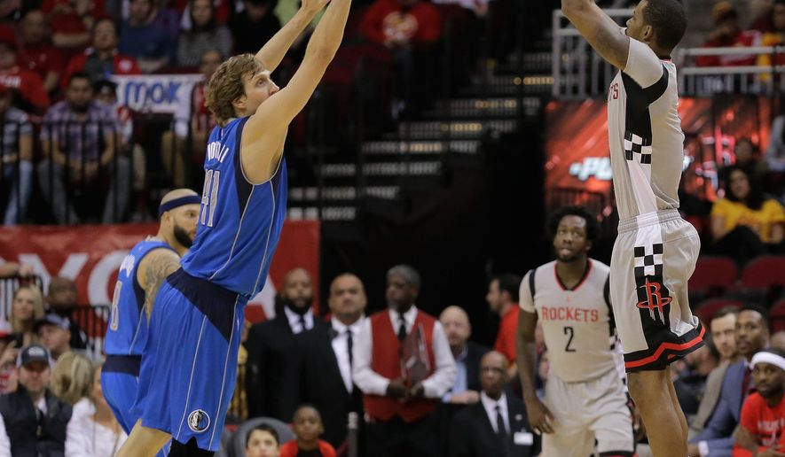 Houston Rockets forward Trevor Ariza (1) shoots over Dallas Mavericks forward Dirk Nowitzki (41) during the first half of an NBA game, Sunday, Jan. 24, 2016 in Houston. (AP Photo/Bob Levey)