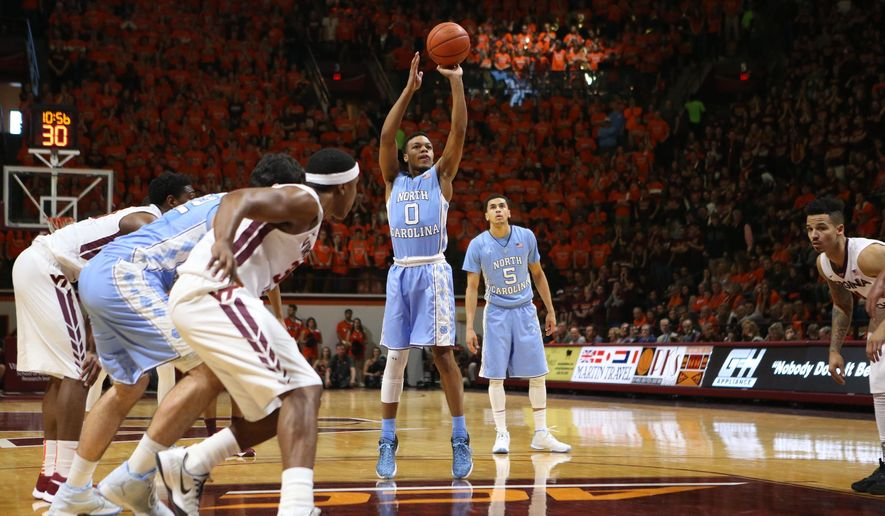 North Carolina's Nate Britt (0) at the foul line during first half action of an NCAA college basketball game against Virginia Tech in Blacksburg, Va. Sunday, Jan. 24, 2016. (Matt Gentry/The Roanoke Times via AP) MANDATORY CREDIT