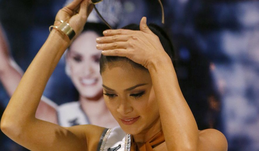 Newly crowned Miss Universe Pia Alonzo Wurtzbach takes off her shades prior to addressing the crowd upon arrival at the Ninoy Aquino International Airport early Saturday, Jan. 23, 2016 in suburban Pasay city south of Manila, Philippines. Wurtzbach was crowned Miss Universe on Dec. 20, 2015 but not before pageant host Steve Harvey incorrectly announced Miss Colombia Ariadna Gutierrez as the winner at the Miss Universe pageant in Las Vegas. (AP Photo/Bullit Marquez)