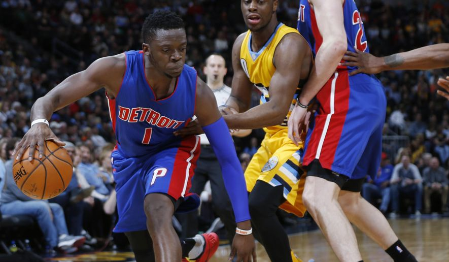 Detroit Pistons guard Reggie Jackson, left, slips past Denver Nuggets guard Emmanuel Mudiay, center, as he gets caught in a pick set by Pistons forward Ersan Ilyasova, of Turkey, in the first half of an NBA basketball game Saturday, Jan. 23, 2016, in Denver. (AP Photo/David Zalubowski)