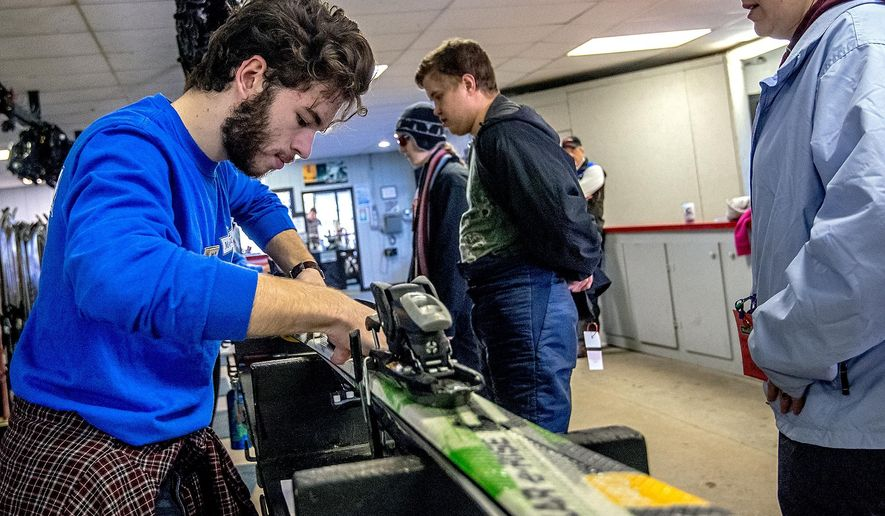 ADVANCE FOR USE MONDAY, JAN. 25, 2016, AND THEREAFTER - In this Thursday, Jan. 14, 2016, photo, Jake Borg, a rental shop employee at Massanutten Resort, works on some skis for a customer at Massanutten's rental shop in Massanutten, Va. Great Eastern Resort announced recently that its companies, including the resort, are under full control of an Employee Stock Ownership Program. In addition to Massanutten, its holdings include Peak Construction Co., headquartered at the resort, and Wilderness Presidential Resort, a campground in western Spotsylvania County. (Austin Bachand/Daily News-Record via AP) MANDATORY CREDIT