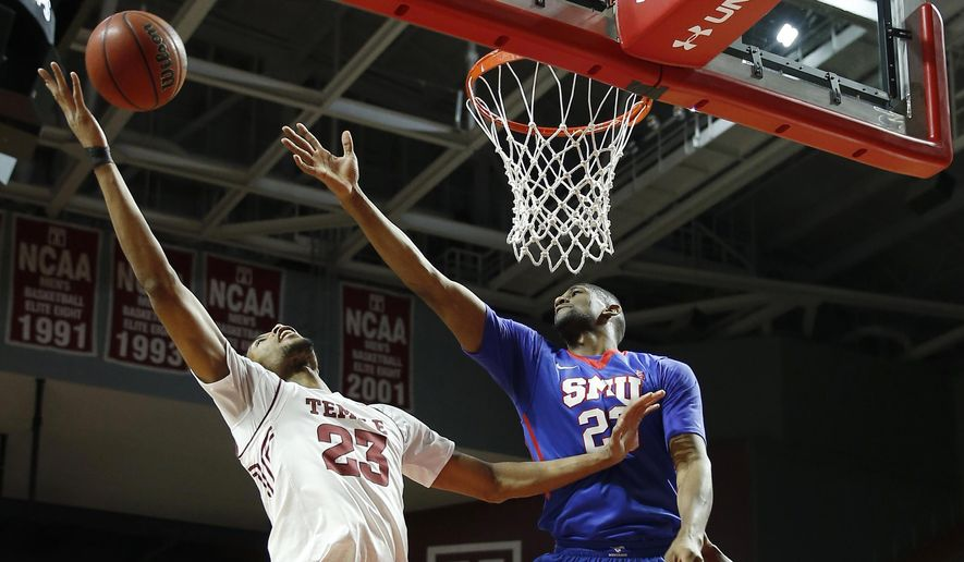 Temple's Devontae Watson, left, pulls in a rebound against SMU's Jordan Tolbert during the first half of an NCAA college basketball game, Sunday, Jan. 24, 2016, in Philadelphia. (AP Photo/Matt Slocum)