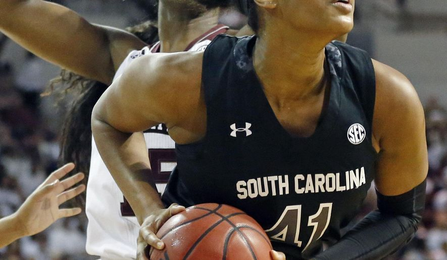 South Carolina center Alaina Coates (41) pulls down a rebound in front of a Mississippi State defender in the first half of an NCAA college basketball game in Starkville, Miss., Sunday, Jan. 24, 2016. (AP Photo/Rogelio V. Solis)