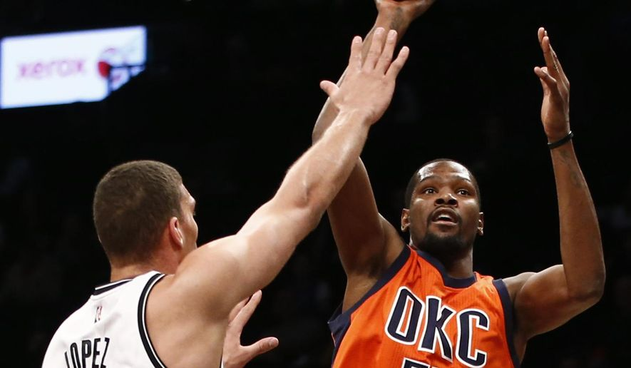 Brooklyn Nets center Brook Lopez (11) defends Oklahoma City Thunder forward Kevin Durant (35) who goes up for a shot in the first half of an NBA basketball game, Sunday, Jan. 24, 2016, in New York. (AP Photo/Kathy Willens)