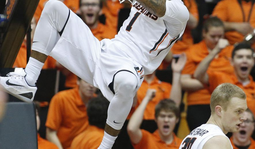 Oregon State's Gary Payton II reacts after a dunk in the first half of an NCAA college basketball game against Southern California, in Corvallis, Ore., on Sunday, Jan. 24, 2016. (AP Photo/Timothy J. Gonzalez)