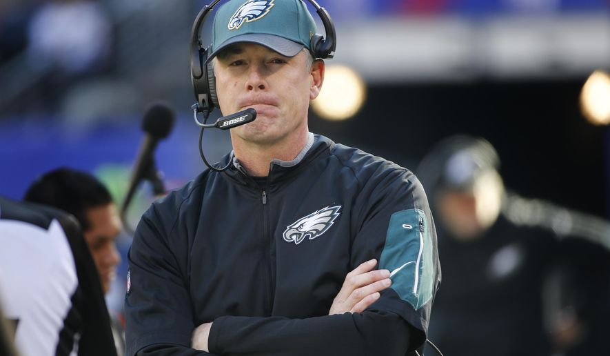 FILE - In this Jan. 3, 2016, file photo, Philadelphia Eagles interim head coach Pat Shurmur watches play from the sidelines during an NFL football game against the New York Giants, in East Rutherford, N.J. According to a person with direct knowledge of the hire who confirmed the agreement to The Associated Press, former Philadelphia offensive coordinator Shurmur has joined Mike Zimmer's staff as an assistant with the Minnesota Vikings. The person spoke to the AP early Sunday, Jan. 24, 2016, on condition of anonymity because the Vikings have not yet announced Shurmur's addition. (AP Photo/Kathy Willens, File)