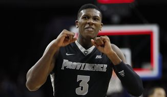 Providence's Kris Dunn reacts during the first half of an NCAA basketball game against Villanova, Sunday, Jan. 24, 2016, in Philadelphia. Providence won 82-76 in overtime. (AP Photo/Chris Szagola)