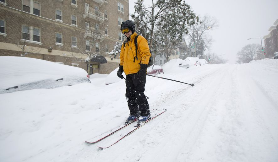 Bryan Gold skis down 13th Street in the Columbia Heights neighborhood of Washington Saturday & D.C. fends off unfavorable NYC comparisons for snow response ...