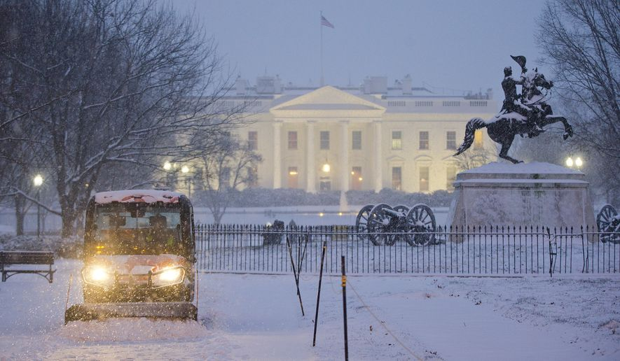 A snowplow begins to clear the sidewalk at Lafayette Park in front of the White House in Washington, Friday, Jan. 22, 2016. The Nation's Capital hunkers down in preparation for a major snowstorm expected to begin later today and with food and supplies vanished from store shelves, five states and the District of Columbia declared states of emergency ahead of the slow-moving system. (AP Photo/Pablo Martinez Monsivais)