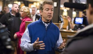 Republican presidential candidate, Sen. Rand Paul, R-Ky, answers an interview question during a campaign stop at the Puritan Backroom restaurant, Friday, Jan. 22, 2016, in Manchester. (AP Photo/John Minchillo)