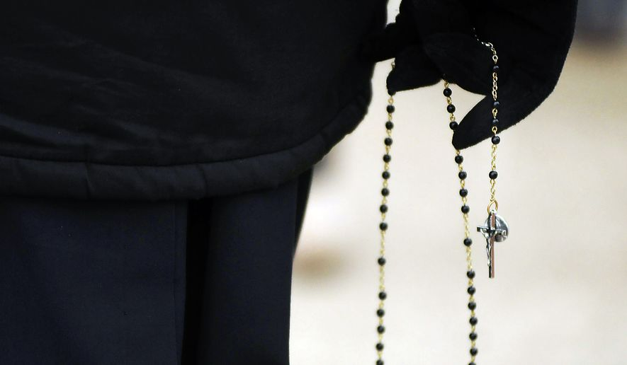 "A nun from Little Sisters of the Poor based in Scranton, Pa., holds her rosary beads as she participates in a ""March For Life"" walk in Dunmore, Pa., on Jan. 22, 2016, the 43rd anniversary of the United States Supreme Court's decision to legalize abortion. (Butch Comegys/The Times & Tribune via AP) **FILE**"