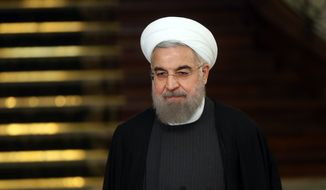 Iranian President Hassan Rouhani attends a joint press conference with his Chinese counterpart Xi Jinping after their meeting at the Saadabad Palace in Tehran, Iran, Saturday, Jan. 23, 2016. (AP Photo/Ebrahim Noroozi) ** FILE **
