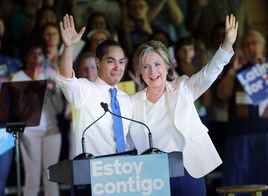 In this Oct. 15, 2015, file photo, Democratic presidential candidate Hillary Clinton, right, stands with Housing and Urban Development Secretary Julian Castro, left, after she was introduced during a campaign event in San Antonio. Clinton hasn't just been wrapping herself in President Barack Obama's legacy lately. She's been wrapping herself in his Cabinet. (AP Photo/Eric Gay, File)