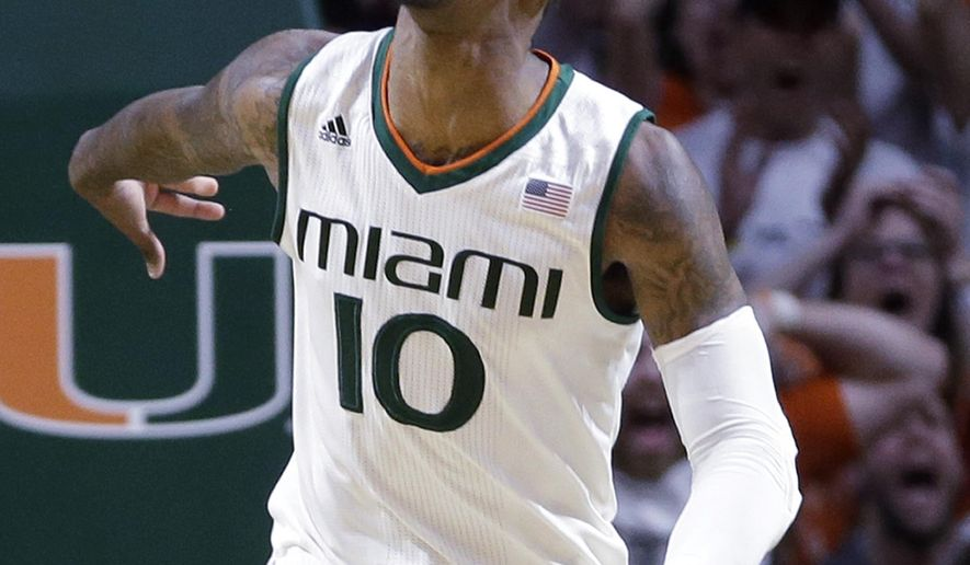 Miami guard Sheldon McClellan (10) celebrates after scoring against Duke during the second half of an NCAA college basketball game, Monday, Jan. 25, 2016, in Coral Gables, Fla. Miami won 80-69. (AP Photo/Alan Diaz)