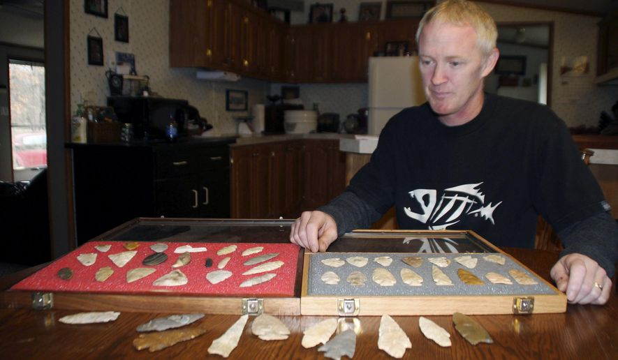 In this Dec. 29, 2015, photo, Josh Wehrle, of Cowden, Ill., a veteran hunter of Indian Stone Age spear- and arrowheads, shows off part of his collection. A well-read collector since he was 10 who still hunts at least once a week, he's amassed more than 3,000 flint projectiles and stone tools. (Tony Reid/Herald & Review via AP)
