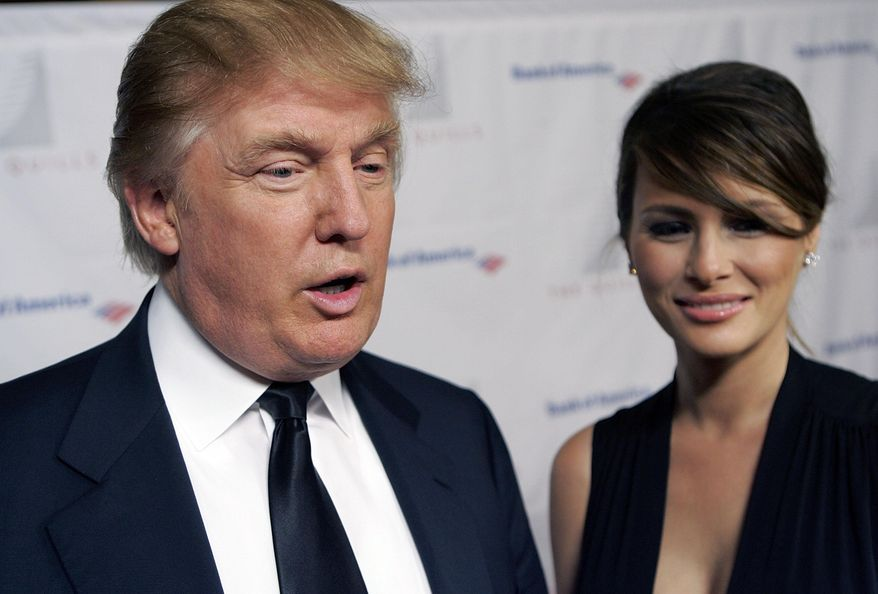 Donald Trump and wife Melania attend the Second Annual Quill Awards at the American Museum of Natural History in New York, in this Oct. 10, 2006, file photo. (AP Photo/Stephen Chernin, File)