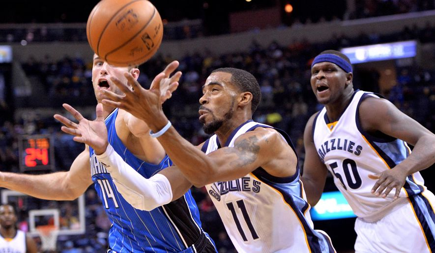 Orlando Magic forward Jason Smith (14) and Memphis Grizzlies guard Mike Conley (11) battle for the ball while Grizzlies forward Zach Randolph (50) looks on in the first half of an NBA basketball game Monday, Jan. 25, 2016, in Memphis, Tenn. (AP Photo/Brandon Dill)