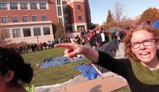 This Nov. 9, 2015, file frame grab provided by Mark Schierbecker shows Melissa Click, right, an assistant professor in the University of Missouri's communications, during a run-in with student journalists at a campus protest that followed the resignations of the  university system's president and the Columbia campus' chancellor in Columbia, Mo. (Mark Schierbecker via AP)