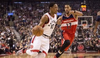 Toronto Raptors' DeMar Derozan drives as Washington Wizards' Garrett Temple defends during the first half of an NBA basketball game Tuesday, Jan. 26, 2016, in Toronto. (Frank Gunn/The Canadian Press via AP)