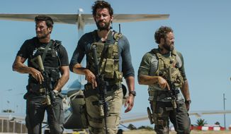 """Military contractors are depicted as heroes in """"13 Hours: The Secret Soldiers of Benghazi."""" (Associated Press/File)"""