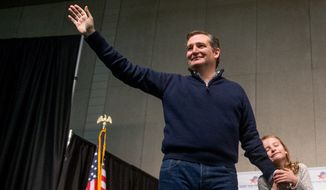 Republican presidential candidate Sen. Ted Cruz, R-Texas, accompanied by his daughter Caroline, 7, right, waves to members of the audience after speaking at a rally at the Five Sullivan Brothers Convention Center in Waterloo, Iowa, Saturday, Jan. 23, 2016. (AP Photo/Andrew Harnik)