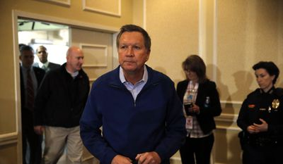 Republican presidential candidate, Ohio Gov. John Kasich walks to the stage to speak Saturday, Jan. 23, 2016, at the New Hampshire Republican Party summit in Nashua, N.H. (AP Photo/Matt Rourke)