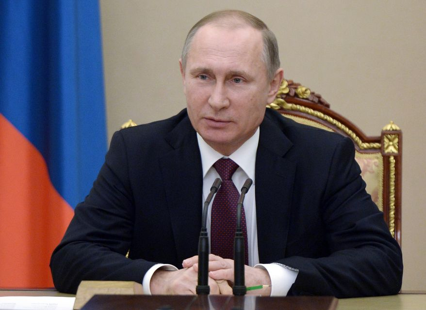 """Asked by a reporter about Donald Trump, Russian President Vladimir Putin called him a """"standout, talented person, without any doubt."""" """"It is not up to us to assess his qualities,"""" Mr. Putin added, """"but he is the absolute leader of the presidential race."""" (Associated Press)"""