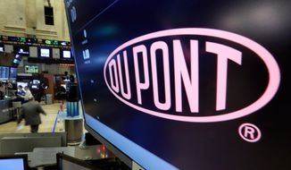 In this Dec. 9, 2015, file photo, the company name of DuPont appears above its trading post on the floor of the New York Stock Exchange. DuPont reports quarterly financial results, Tuesday, Jan. 26, 2016. (AP Photo/Richard Drew, File)