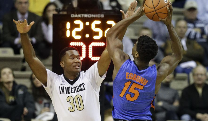 Vanderbilt center Damian Jones (30) defends against Florida center John Egbunu (15) in the first half of an NCAA college basketball game Tuesday, Jan. 26, 2016, in Nashville, Tenn. (AP Photo/Mark Humphrey)