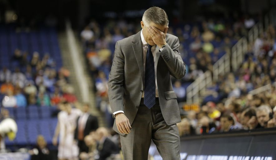 FILE - In this March 10, 2015, file photo, Georgia Tech head coach Brian Gregory reacts after a turnover during the first half of an NCAA college basketball game against Boston College in the first round of the Atlantic Coast Conference tournament in Greensboro, N.C. The Yellow Jackets play in the Atlantic Coast Conference. They have a marvelous new arena. They're in the midst of a stellar recruiting base. Yet, they haven't been to the NCAA tournament since 2010, haven't been much of a factor since reaching the national championship game a dozen years ago, and now comes a 1-5 start in the ACC.  (AP Photo/Gerry Broome, File)