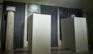 In this Monday, Jan. 25, 2016 photo, plywood panels cover naked statues inside the Campidoglio, Capitol Hill, during a meeting between Italian Premier Matteo Renzi and Iranian President Hassan Rouhani, in Rome, Italy, January 25, 2016. (Giuseppe Lami/ANSA via AP) ITALY OUT