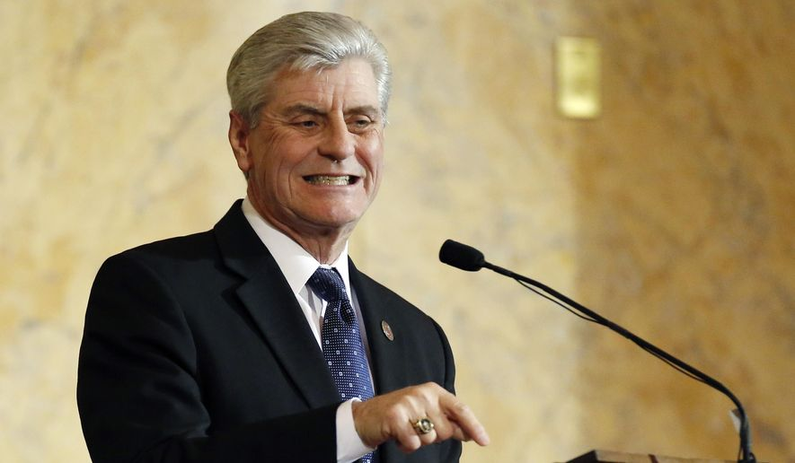 Republican Gov. Phil Bryant delivers his State of the State address before a joint legislative session in House chambers at the Capitol in Jackson, Miss., Tuesday, Jan. 26, 2016. (AP Photo/Rogelio V. Solis) ** FILE **