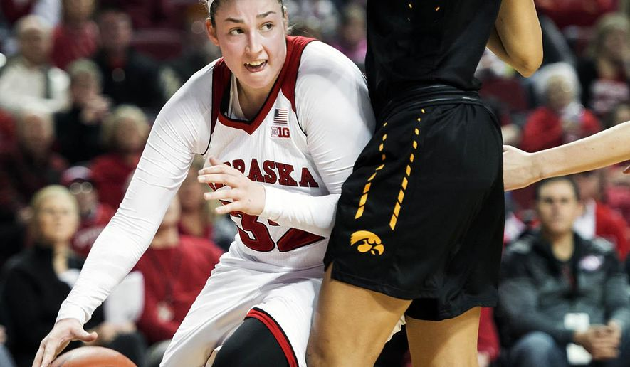 FILE - In this Dec. 31, 2015, file photo, Nebraska forward Jessica Shepard (32) tries to drive the baseline around Iowa forward Chase Coley (4) during the first half of an NCAA college basketball game, at Pinnacle Bank Arena in Lincoln, Neb. Shepard has lived up to the hype that goes with being one of the nation's top women's basketball recruits. (Kristin Streff/The Journal-Star via AP, File) LOCAL TELEVISION OUT; KOLN-TV OUT; KGIN-TV OUT; KLKN-TV OUT; MANDATORY CREDIT