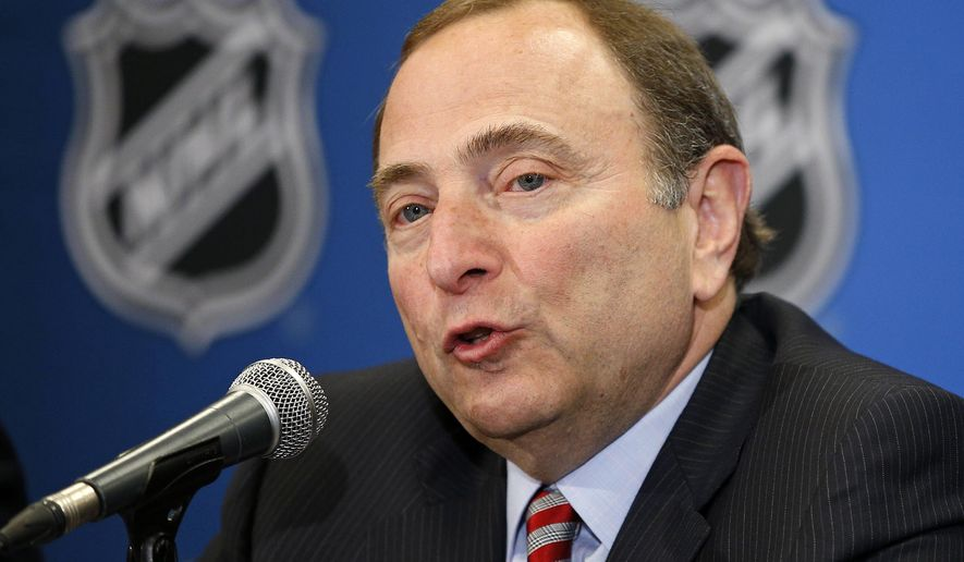 """FILE - In this Wednesday, June 24, 2015, file photo, NHL commissioner Gary Bettman speaks at a news conference before the NHL Awards show in Las Vegas. Major League Baseball is debuting a new website and apps, for ice hockey. Under a deal reached in the summer of 2015, baseball's digital business has taken over streaming and app development for the National Hockey League. Bettman said the NHL has been exploring various puck- and player-tracking technologies, but hockey is harder to track """"than baseball or football because it's non-stop action and an incredible speed, particularly with the puck."""" (AP Photo/John Locher, File)"""