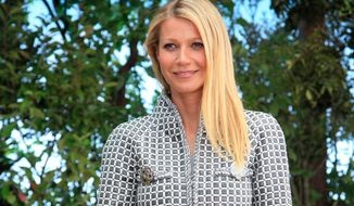US actress Gwyneth Paltrow poses for photographers before Chanel's Spring-Summer 2016 Haute Couture fashion collection in Paris, Tuesday, Jan.26, 2016. (AP Photo/Thibault Camus)