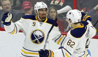 Buffalo Sabres' Evander Kane (9)celebrates his goal against the Ottawa Senators with teammate Marcus Foligno (82) during first period NHL hockey action in Ottawa, Ontario, Tuesday, Jan. 26, 2016. (Fred Chartrand/The Canadian Press via AP) MANDATORY CREDIT