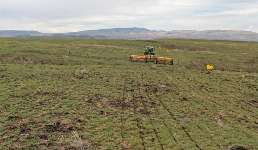 In this 2015 photo provided by the Bureau of Land Management, a rangeland drill reseeds an area burned by the Soda Fire in southwest Idaho. A year after Interior Secretary Sally Jewell shifted the national approach to fighting wildfires across a wide swath of sagebrush country in the West, in an order issued in January 2015, her strategy is turning out to be one of the most significant federal land policy changes in some 80 years, public land experts, outdoor enthusiasts and scientists say. (Bureau of Land Management via AP)