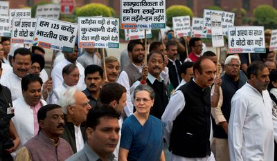 Concerned: Sonia Gandhi (center in blue), leader of India's opposition Congress party, leads a protest against religious bigotry and rising communal violence in the country. She says she is worried about Prime Minister Narendra Modi's relative silence through it all. (Associated Press)