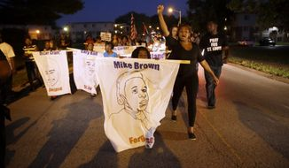 """Ferguson, Missouri, became a federal focus over policing as riots and protests erupted in the wake of the 2014 fatal shooting of an 18-year-old black man by a city police officer. The Justice Department later determined that the police department and municipal court had engaged in a """"pattern and practice"""" of discrimination against black residents. (Associated Press/File)"""