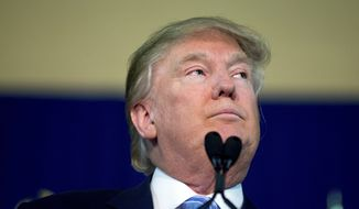 Republican presidential candidate Donald Trump pauses as he speaks at a rally at Muscatine High School in Muscatine, Iowa, Sunday, Jan. 24, 2016. (AP Photo/Andrew Harnik)