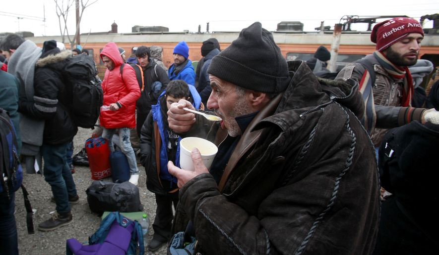 Refugees have a hot soup on the arrival at the transit center for refugees near northern Macedonian village of Tabanovce, before continuing their journey to Serbia, Sunday, Jan. 24, 2016. Macedonia, Serbia and Croatia, the countries on the so-called Balkan migrant corridor that starts in Greece, are only letting in people whose stated final destination is Germany or Austria. (AP Photo/Boris Grdanoski)