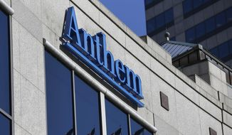 In this Thursday, Feb. 5, 2015, file photo, the Anthem logo hangs at the health insurer's corporate headquarters in Indianapolis. Anthem reports financial results, Wednesday, Jan. 27, 2016. (AP Photo/Michael Conroy, File)