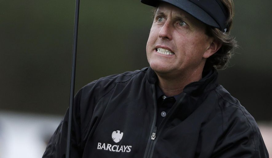 FILE - In this Jan. 24, 2013, file photo, Phil Mickelson grimaces as he watches his tee shot on the 10th hole of the north course at the Torrey Pines Golf Course during the first round of the Farmers Insurance Open golf tournament, in San Diego. The best thing about playing Torrey Pines for Phil Mickelson is that it's his hometown event on the PGA Tour. That might be the only thing he finds favorable.  (AP Photo/Gregory Bull, File)
